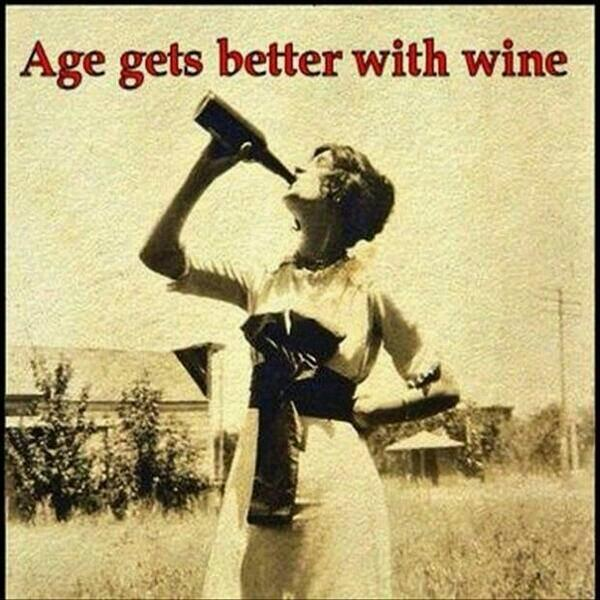 Old photo of a woman guzzling a bottle of wine.
